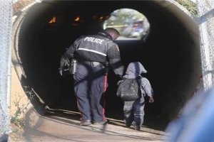 Saskatoon Police Service - Officer walking with young child with backpack